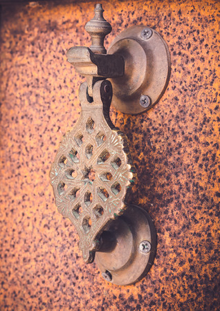 Moroccan style door handles are carved beautifully.