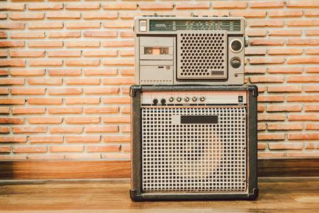 Retro radios and retro speakers on the background of brick walls. Reklamní fotografie