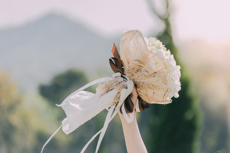 Beautiful bouquet in the brides hands on the wedding day. Reklamní fotografie