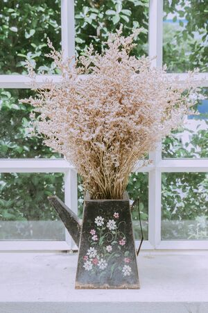 Dried flowers in vases for home decoration.