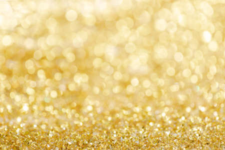 Gold light Festive Christmas background. Abstract twinkled bright background with bokeh defocused golden lights Foto de archivo