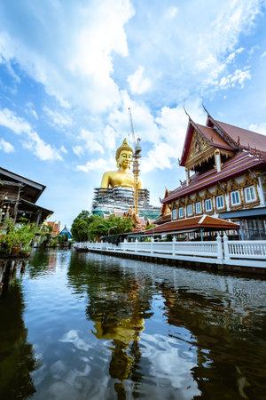 Big golden Buddha statue named