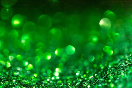 Green glitter vintage lights background defocused for festivals and celebrations Standard-Bild