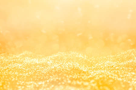 Beautiful winter bokeh and texture blurred abstract background with bright, glitter like stars.