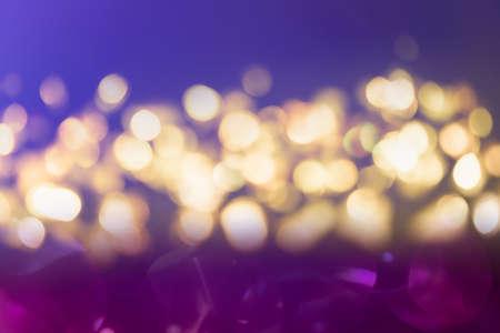 Purple and blue glitter vintage lights background defocused for festivals and celebrations Standard-Bild