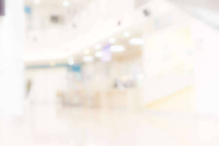 Blur light background at shop in mall for business background, Abstract blurry bokeh at interior hallway Standard-Bild