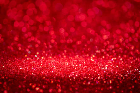 Red abstract light background blurred bokeh image  defocused for festivals and celebrations.