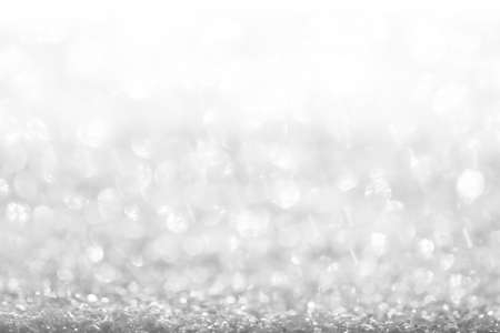 white, silver glitter vintage lights background defocused for festivals and celebrations