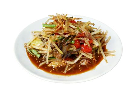 Spicy papaya salad (Som Tum) Thai traditional food isolated on white background Stock Photo