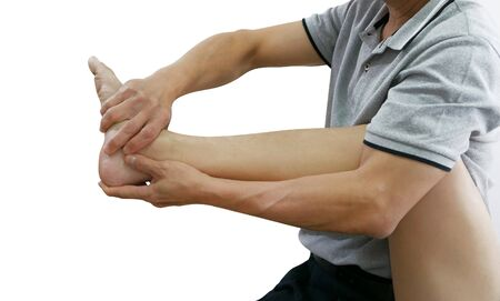Physical therapist treats foot and leg to the patient on white background Reklamní fotografie