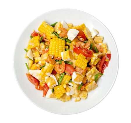 Thai style spicy corn salad with salted eggs, delicious popular Thai traditional food isolated on white background,