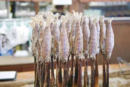 Traditional japanese style grilled fish Ayu stick with salt in local restaurant at Takayama, Japan