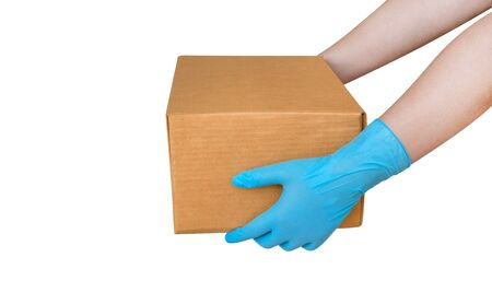 Hand wearing blue glove for protect allergic reaction or infectious diseases coronavirus/covid-19 holding paper box deliver goods to customer isolated on white background, clipping path included Reklamní fotografie