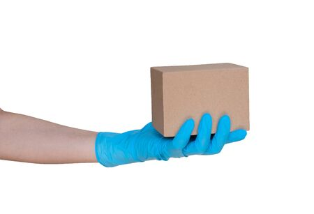 Hand wearing blue glove for protect allergic reaction or infectious diseases coronavirus/covid-19 holding small paper box deliver goods to customer isolated on white background, clipping path included Reklamní fotografie