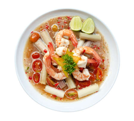 Thai style spicy seafood shrimp salad (yum) with lotus stem in ceramic plate top view isolated on the white background