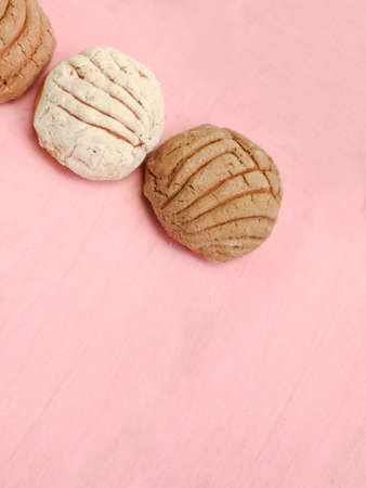 traditional mexican bread shells on pink background, top view