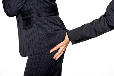 Touching a business womans butt Stock Photo