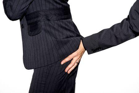 Touching a business womans butt Stock Photo