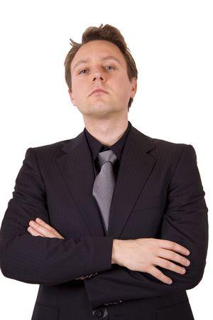 arrogancia: Un arrogante hombre de negocios con los brazos cruzados