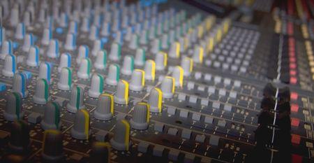A foto of a mixer in a recording studio