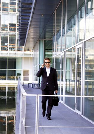 Businessman walking outside the office photo