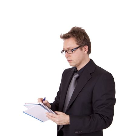 evaluating: A serious business man is taking notes