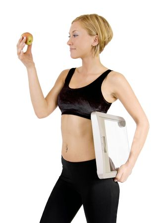 Woman with apple and scale Stock Photo - 4890724