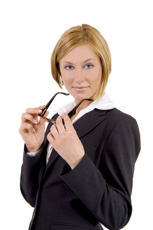 A beutiful blond business woman is holding her glasses photo