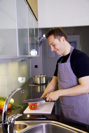 Man making dinner in a modern kitchen photo