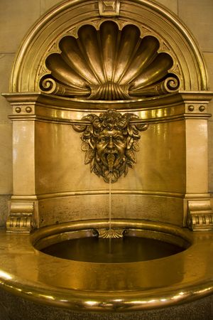 baptismal: Baptismal font in gold in a church