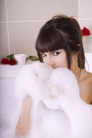 Woman in a pool is having fun with the foam Stock Photo - 5318092