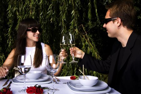 Couple having a romantic lunch in the garden enjoying wine Stock Photo - 5318041