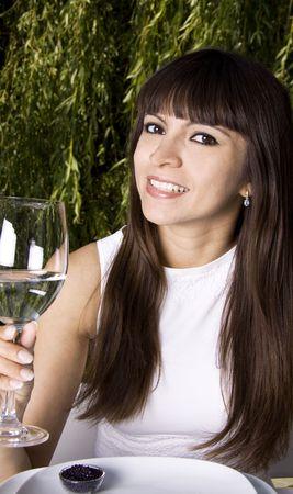 Beautiful latina woman is drinking water outside photo