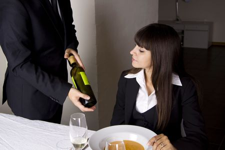 Business woman is ordering wine at a fine restaurant Stock Photo