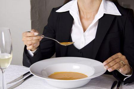 Business woman is having lunch at a frensh gourmet restaurant.