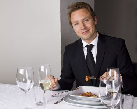 Business man is having lunch at a frensh gourmet restaurant. photo