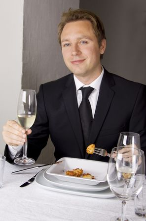 Business man is having lunch at a frensh gourmet restaurant. Stock Photo