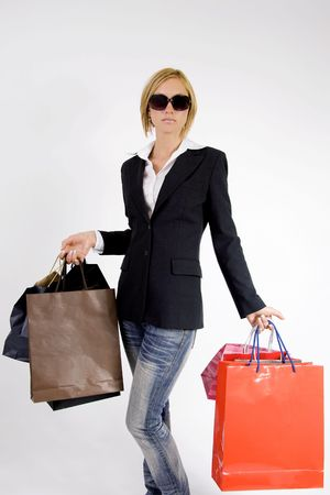 Blond woman with shopping bags in various  colors Stock Photo - 5477464