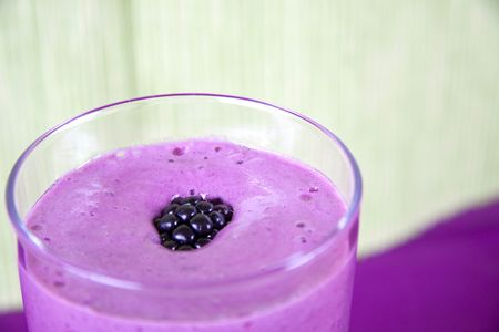 Delicious frozen smoothie with  strawberry, mint and blackberry