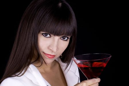 Woman with a red cocktail wearing a white coat Stock Photo - 5912468