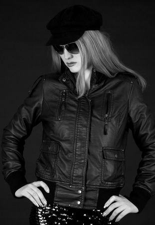 Blond fashion model in a leather jacket and a beret