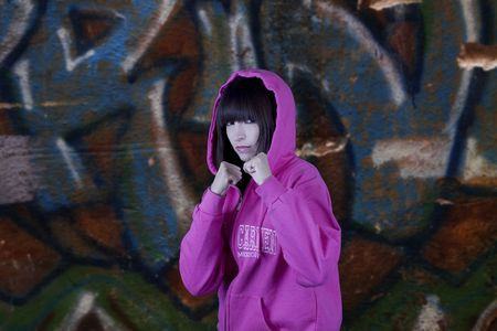 Tough hip hop girl and a graffiti background photo