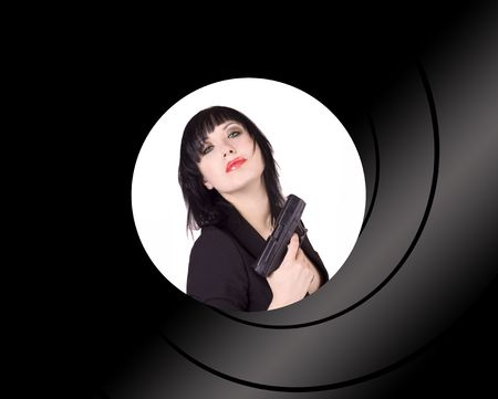 Beautiful black haired woman with a gun Stock Photo