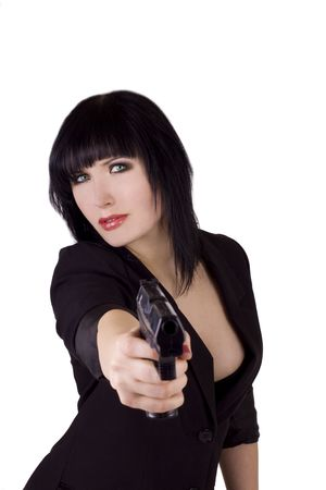 Beautiful black haired woman pointing a gun at you photo