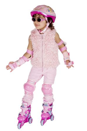 Afro american girl in a pink outfit on rollerskates