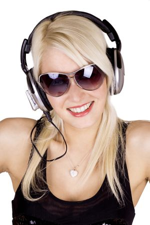Blond girl listening to music wearing headphones Stock Photo
