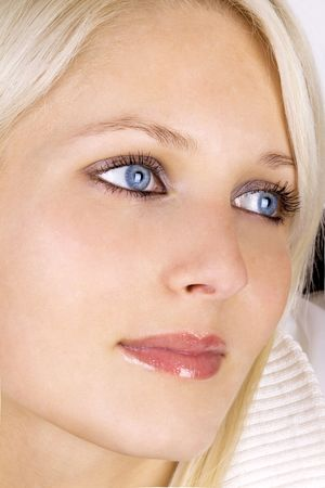 Close-up of �beautiful blond girl with natural make-up photo
