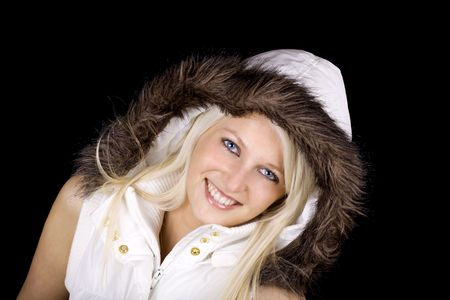 Beautiful blond woman with fur coat photo