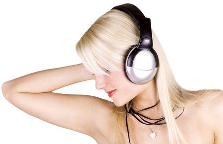 Beautiful blond girl wearing headphones