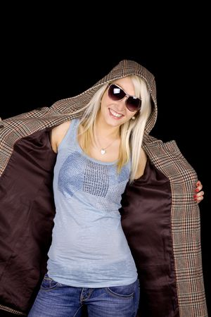 Beautiful blond girl with fashionable coat and sun glasses Stock Photo